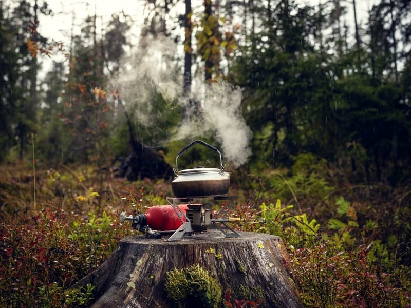Some camping stoves can burn on normal fuel that your adventure bike runs on