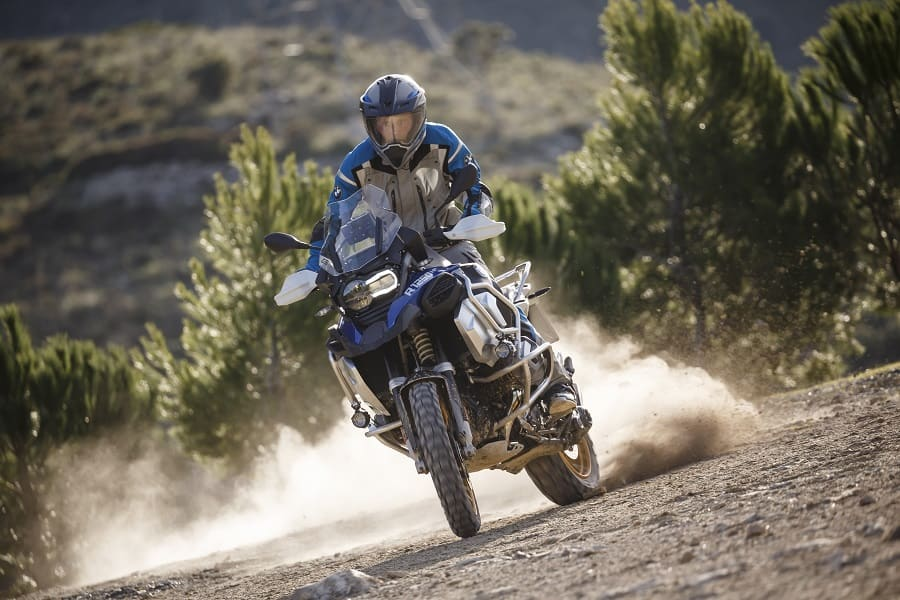 Rider standing up to control the bike in the dirt