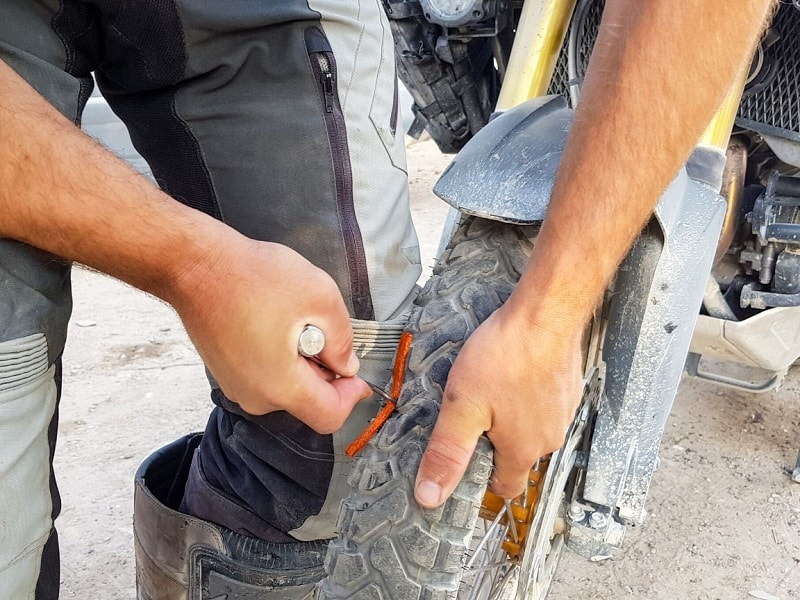 Fixing a tire with a repair kit