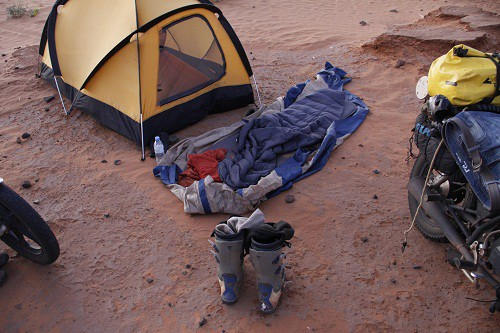 Sleeping under the starts outside the tent on an adventure bike trip through Sudan