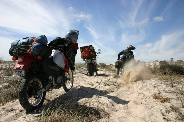 Riding in thick sand with heavily laden adventure bikes