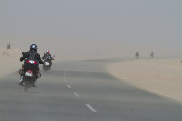 Strong side wind on a motorcycle trip through Namibia